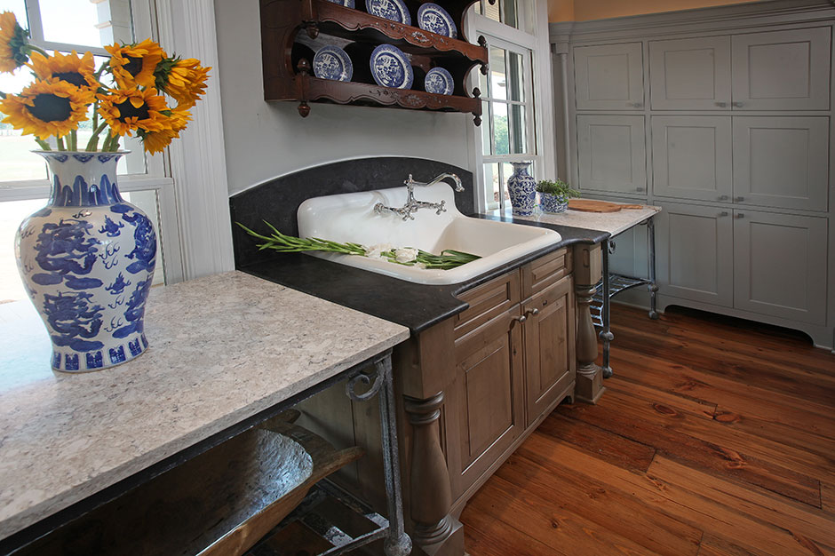 An Antique Piece Over The Sink Is Used To House Vintage Dinnerware, And A  Vintage Armoire Conceals The Pantry Storage.
